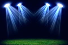 Grass field lit with bright spotlights Stock Illustration