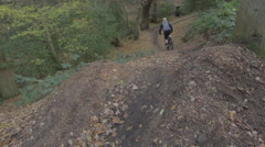 Mountain Biker Jump - Wide Slow Camera Track Out - Shot 5 of 5 Stock Footage