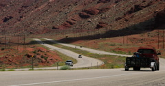 Moab southern Utah red rock canyon highway traffic DCI 4K Stock Footage