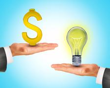 Light bulb in hands with dollar sign Stock Photos