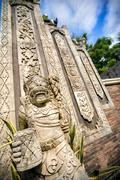 Statues and carvings depicting demons, gods and Balinese mythological deities - stock photo