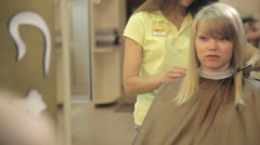 professional hair stylist with scissors - stock footage