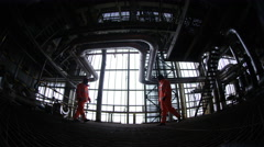 4K Distorted view of engineers shaking hands in industrial plant. - stock footage