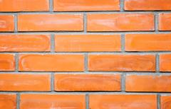 A fragment of a brick wall . (Background image) Stock Photos