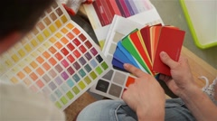 Young couple selecting a color for a condo, close-up - stock footage
