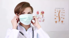 Doctor working putting her medical mask. Medical Concept Stock Footage