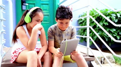 Young boy and girl with digital tablet 4 Stock Footage