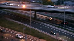 Road traffic scene with bridge in the dusk. - stock footage