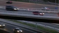 Close-up road traffic scene with bridge in the dusk. - stock footage