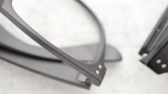 Eyeglasses in close up on stone table with slow sliding motion Stock Footage