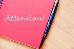Attention write on notebook Stock Photos