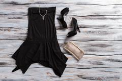 Black evening dress and heels. - stock photo