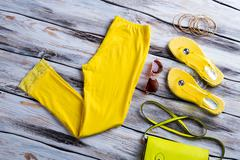 Bright yellow pants and footwear. Stock Photos