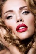 Make up. Glamour portrait of beautiful woman model with fresh makeup and Stock Photos