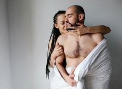 Man and woman in the bedroom Stock Photos