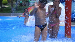 Child having fun at water park - stock footage