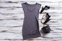 Gray sleeveless top and heels. - stock photo