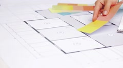 Woman with blueprint and swatches choosing color Stock Footage