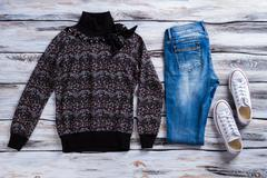 Dark sweater and blue jeans. Stock Photos