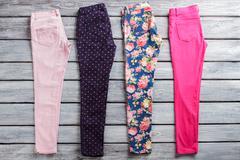 Dark navy and pink pants. Stock Photos
