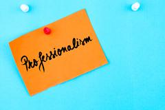 Professionalism written on orange paper note Stock Photos