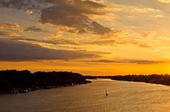 Sailboat at sunset on Sava river in Belgrade - stock photo