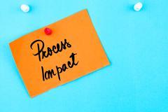 Process Impact written on orange paper note - stock photo