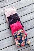 Light pink and navy pants. Stock Photos