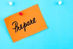 Prepare written on orange paper note - stock photo