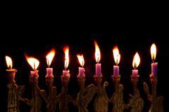 Hanukkah candles on black background Stock Photos