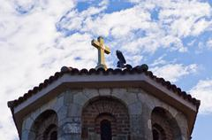 Bird and the golden cross on a church roof at Kalemegdan fortress in Belgrade Stock Photos