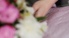 Bouquet making process in a flower store - stock footage