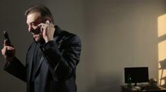Angry businessman waving his gun, said by telephone. threatening interlocutor Stock Footage