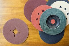 Abrasive materials - sheets of sandpaper and disks close-up - stock photo