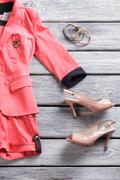 Salmon short suit and heels. - stock photo