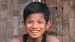 Portrait of a poor boy on the street in Mrauk U, Myanmar. Burma Stock Footage