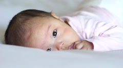 3 months old Asian Chinese Baby on bed in slow motion Stock Footage