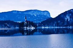 Winter morning and thin ice reflections on lake Bled in slovenian alps - stock photo