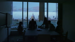 4K Business group in silhouette take their seats for a meeting in London office - stock footage