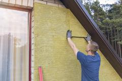 House insulation - insulating house facade with mineral rock wool Stock Photos