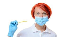 Close up of red headed health care professional - stock photo