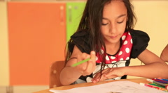 Cute little prescool girl drawing with colorful pencils 4 - stock footage
