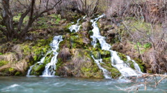 The falls which are flowing down the cascade to the river Stock Footage