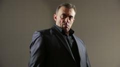 Businessman Pointing Hand Gun. gangster threatens gun. a brutal man in a Stock Footage