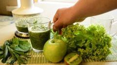 Still life with freshly cooked green smoothie, cocktail and fruit, herbs Stock Footage