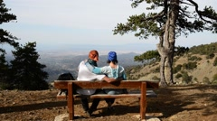 Couple during a trip, rest, sitting on a bench Stock Footage
