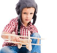 little boy with pilot hat and toy airplane - stock photo