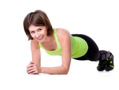 sport woman doing the plank exercise on the floor - stock photo