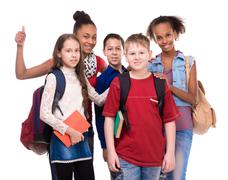 Pupils with different complexion and clothes Stock Photos