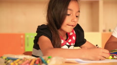 Cute little prescool girl drawing with colorful pencils 6 - stock footage
